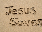 jesus-saves-written-on-a-sandy-beach.jpg